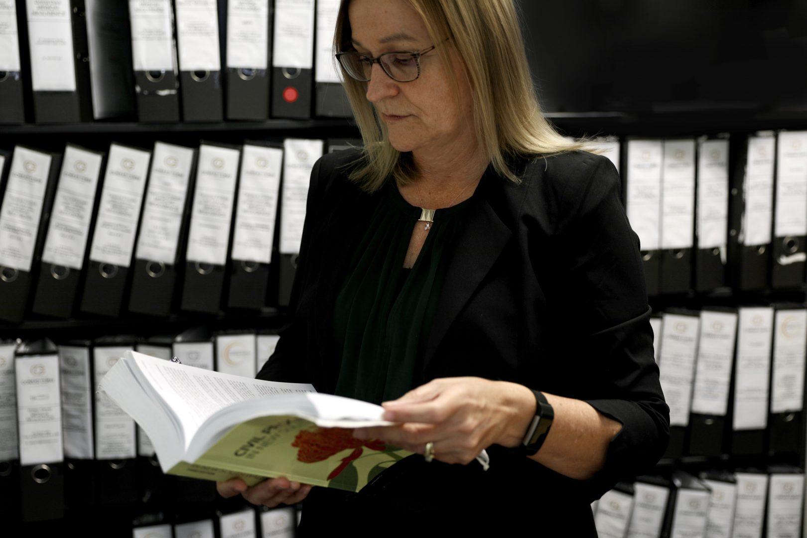 Henriette Boonen Reviewing Files